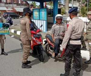 Tim Gabungan TNI-Polri dan Sapol PP Gelar Operasi Yustisi COVID-19
